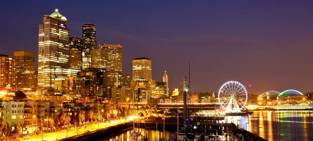 Night view of Seattle skyline lit up with lights
