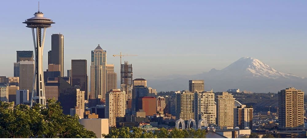 seattle skyline featuring sky scrappers with blue sky in background